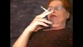 fuk move son mother Candi smokes in gren satin blouse and leather skirt